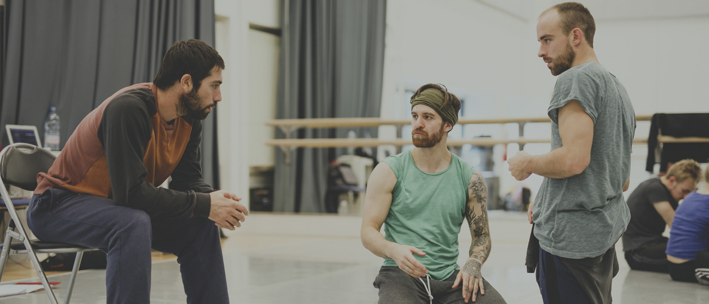 a choreographer talking to two dancers