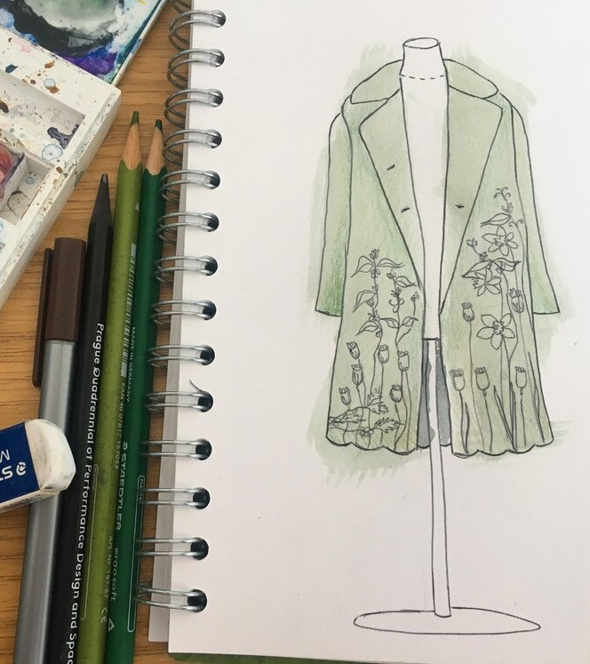 sketch of green coat with embroidered flowers