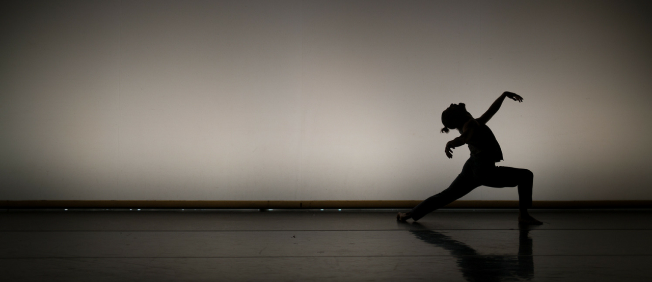 tuplet, dancer silhouetted against a white background
