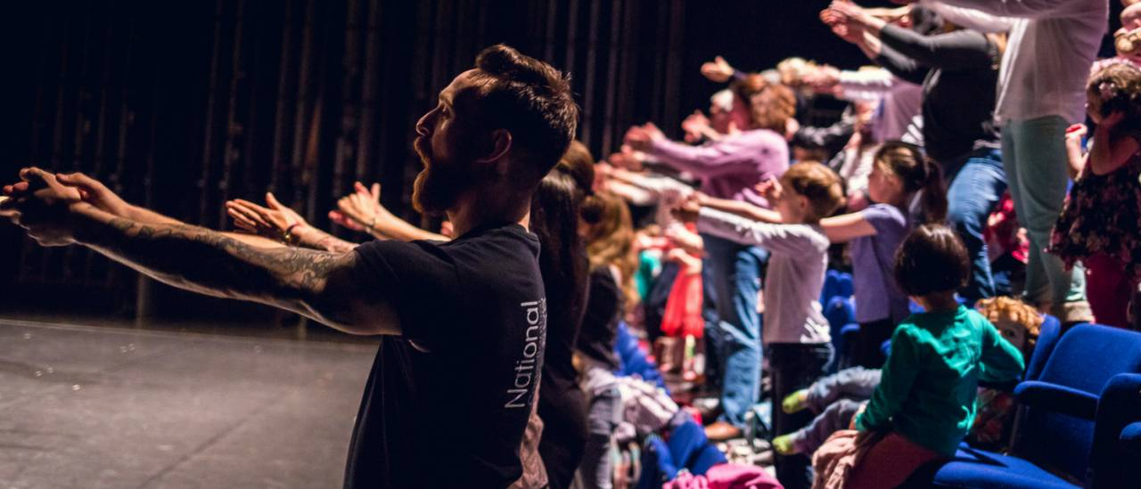 Discover Dance performance, dancer stretching out with audience