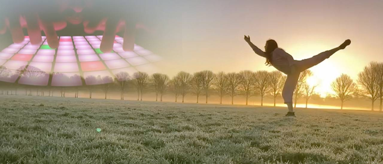 image of a dancer with the sun rising in the background and in the back a music machine playing