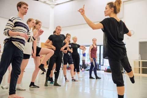 Professional dancer taking a class with young dancers