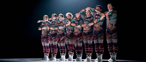 Tundra line of 8 dancers arms intertwined