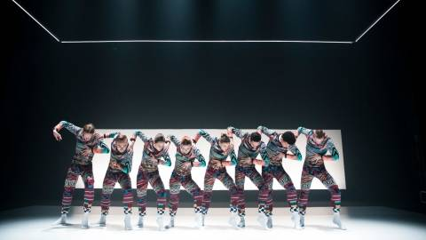 8 dancers in a row heads facing down
