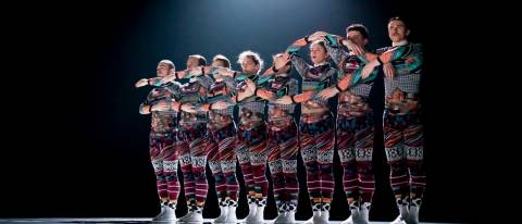 Tundra image, dancers in a line arms joined up