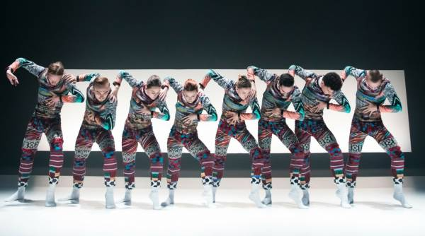 Tundra all dancers in a row with right arm in the air at a right angle